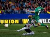 Rubin Kazan's Gokdeniz Karadeniz scores the opener in the Europa League match against Atletico Madrid on February 14, 2013