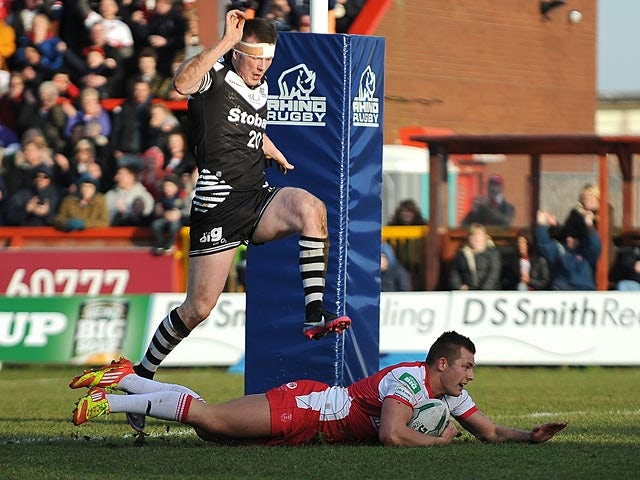 Hull KR's Greg Eden scores his team's sixth try against Widnes Vikings on February 17, 2013