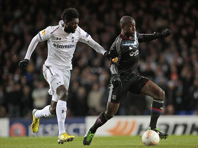 Tottenham Hotspur's Emmanuel Adebayor and Lyon's Gueida Fofana battle for the ball on February 14, 2013