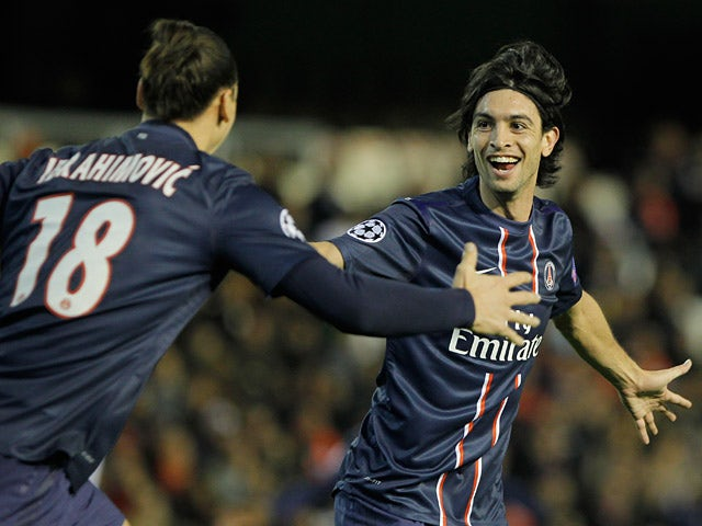 Paris Saint-Germain's Javier Pastore celebrates with team mate Zlatan Ibrahimovic after scoring his team's second against Valencia on February 12, 2013