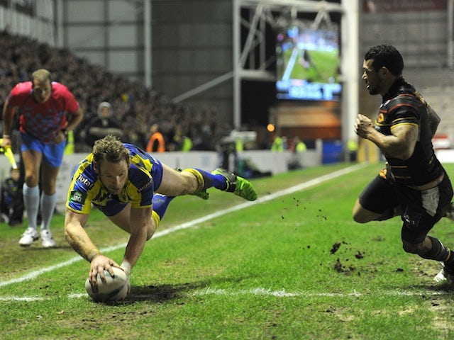 Warrington's Joel Monaghan dives in a try against Catalan Dragons on February 15, 2013