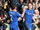 Chelsea's John Terry is congratulated by Branislav Ivanovic after scoring his team's fourth in the FA Cup 4th round replay against Brentford on February 17, 2013