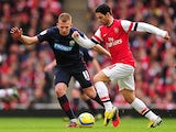Arsenal's Mikel Arteta and Blackburn's Jordan Rhodes battle for the ball during the FA Cup fifth round tie on February 16, 2013