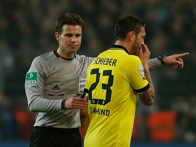 Dortmund's Julian Schieber moments after being sent off in the match against Frankfurt on February 16, 2013