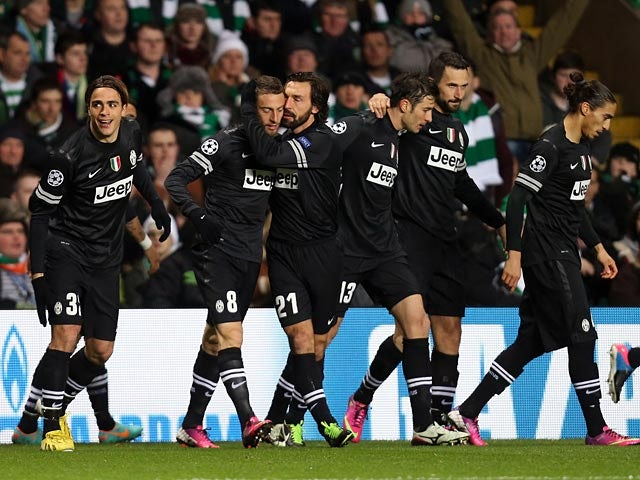 Juventus' Claudio Marchisio is congratulated by team mates after scoring the opening goal against Celtic on February 12, 2013