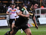 Castleford Tigers' Kirk Dixon runs clear to score a try against Bradford Bulls on February 16, 2013
