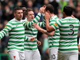 Celtic's Kris Commons is congratulated by team mates after scoring his team's second against Dundee United on February 16, 2013