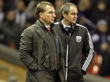 Liverpool manager Brendan Rodgers and West Brom manager Steve Clarke watch on during their teams encounter on February 11, 2013
