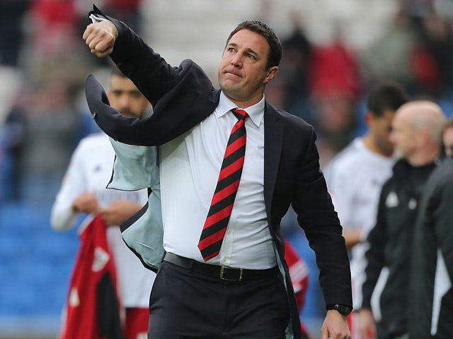 Cardiff boss Malky Mackay celebrates victory over Bristol City at the final whistle on February 16, 2013