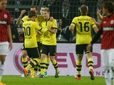 Dortmund's Marco Reus is congratulated by team mates after scoring against Frankfurt on February 16, 2013