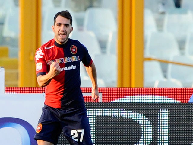 Cagliari's Marco Sau celebrates after scoring the opening goal against Pescara on February 17, 2013