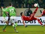 Bayern forward Mario Mandzukic scores against Wolfsburg on February 15, 2013