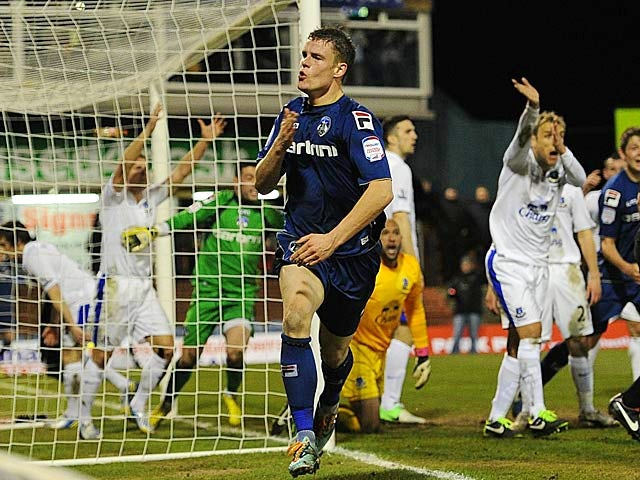 Oldham's Matt Smith celebrates after heading in the equaliser against Everton in the FA Cup 5th round on February 16, 2013