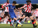 Chelsea's Oscar and Brentford's Jonathan Douglas battle for the ball in their FA Cup 4th round replay on February 17, 2013