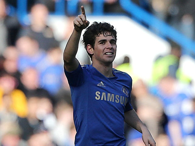 Chelsea's Oscar celebrates scoring the his team's second in the FA Cup 4th round replay against Brentford on February 17, 2013