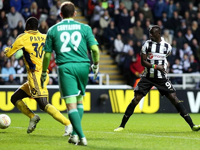 Papiss Cisse scores a goal which is ruled out during the Europa League against Metalist Kharkiv on February 14, 2013