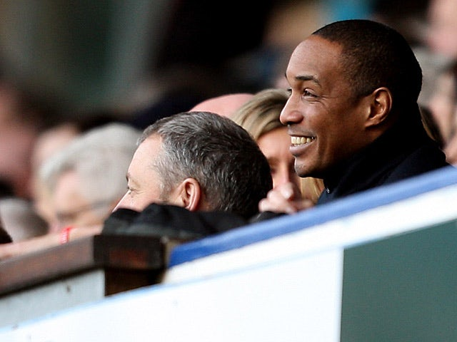 Paul Ince smiles in the directors box as he watches Blackpool play Ipswich on February 16, 2013