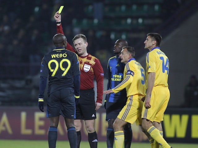 Fenerbahce's Pierre Webo receives a booking against Bate on February 14, 2013