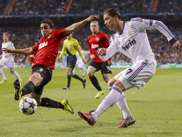 Real Madrid's Cristiano Ronaldo crosses during his team's match with Manchester United on February 13, 2013