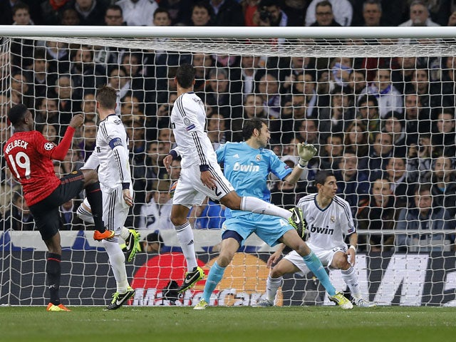 Manchester United's Danny Welbeck scores his side's first goal against Real Madrid on February 13, 2013