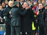 Real Madrid manager José Mourinho and Manchester United manager Sir Alex Ferguson during their sides games on February 13, 2013