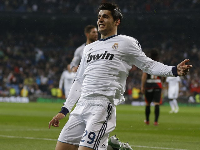 Real Madrid's Alvaro Morata celebrates scoring against Rayo Vallecano on February 17, 2013