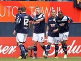 Millwall's Rob Hulse is congratulated by team mates after scoring his team's second in the FA Cup 5th round tie against Luton on February 16, 2013