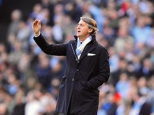 Mancini: 'Title race is on'