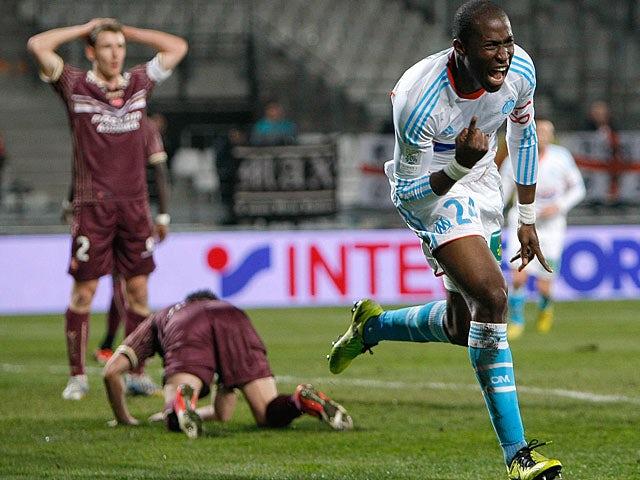 Marseille defender Rod Fanni celebrates after scoring against Valenciennes on February 16, 2013