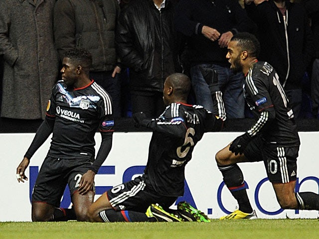 Lyon's Samuel Umtiti celebrates his goal with team mates during the Europa League match against Tottenham Hotspur on February 14, 2013