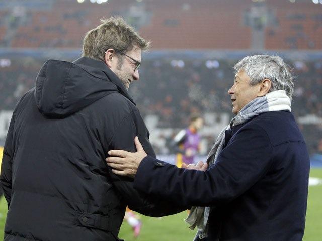 Shaktar Donetsk coach Mircea Lucescu and Dortmund coach Jurgen Klopp before their sides clash on February 13, 2013