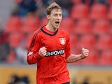 Leverkusen's Stefan Kiessling celebrates scoring the opener against Augsburg on February 16, 2013