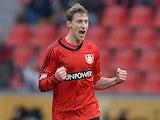 Leverkusen's Stefan Kiessling celebrates scoring the opener against Augsburg on February 16, 2013