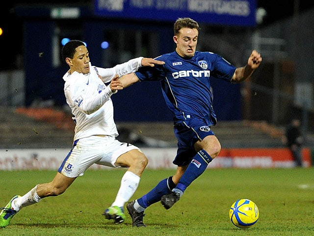 Everton's Steven Pienaar and Oldham's Jose Baxter battle for the ball during their FA Cup 5th round match on February 16, 2013