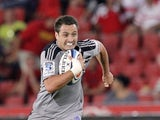 Zealand's Hurricanes Tim Bateman runs with the ball during their Super Rugby match against Lions on March 2, 2012