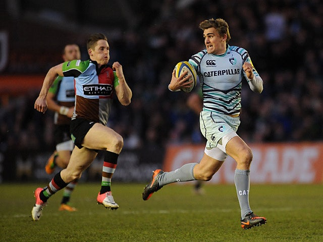 Leciester Tigers' Toby Flood runs away to score the first try of the match against Harlequins on February 16, 2013