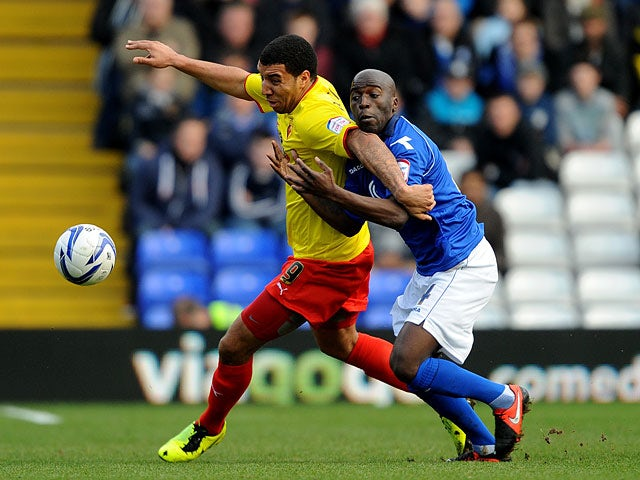 Watford's Troy Deeney and Birmingham's Morgaro Gomis battle for the ball on February 16, 2013