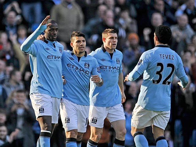 Manchester City's Yaya Toure is congratulated by team mates after scoring the opener against Leeds in the FA Cup 5th round on February 17, 2013