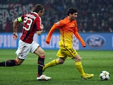 Barcelona's Lionel Messi is chased by AC Milan's Massimo Ambrosini during the two sides Champions League match on February 20, 2013