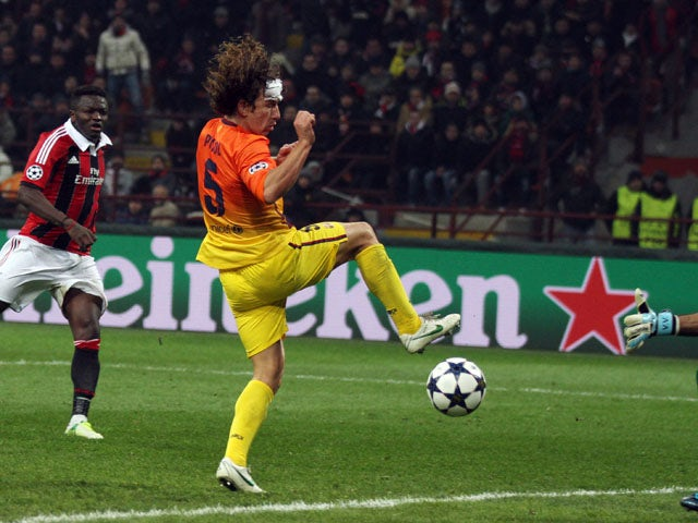 AC Milan's Sulley Muntari scores for his side against Barcelona in the Champions League round of 16 on February 20, 2013