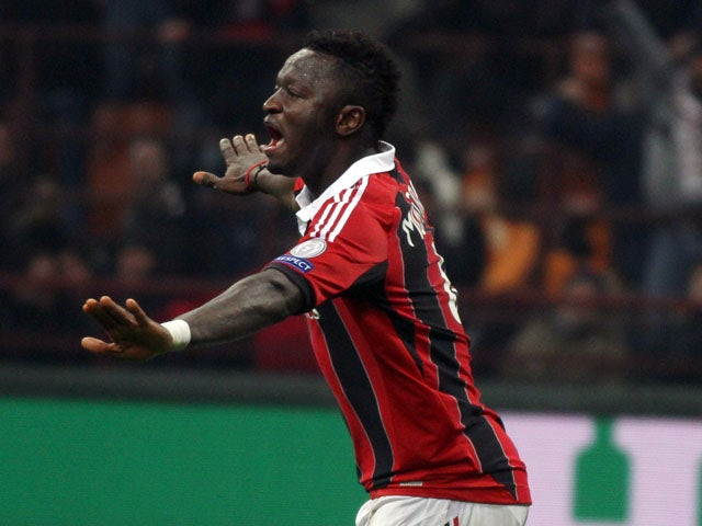 AC Milan's Sulley Muntari celebrates after scoring against Barcelona in the Champions League round of 16 on February 20, 2013