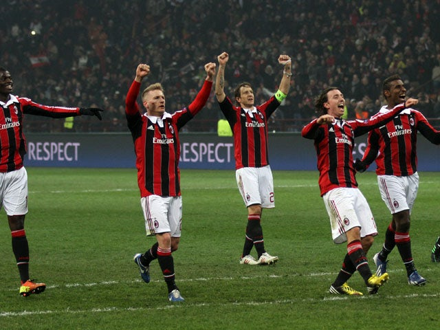 AC Milan players celebrate after defeating Barcelona on February 20, 2013