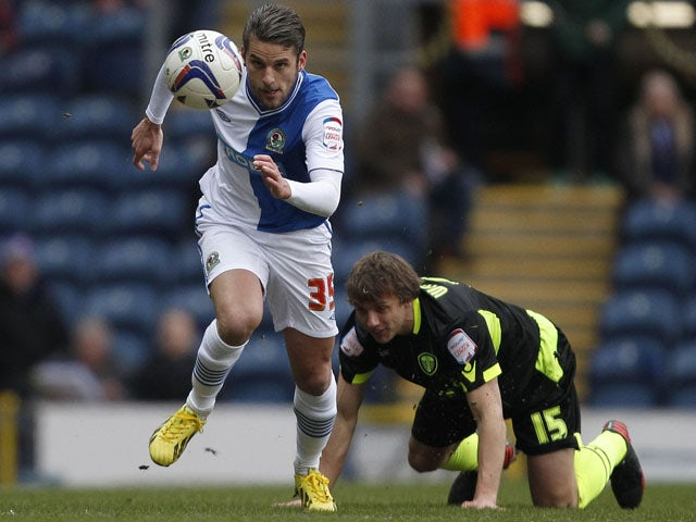 Blackburn Rovers David Bentley gets away from Leeds United's Stephen Warnock during the two sides match on February 23, 2013
