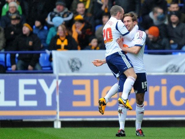 Bolton Wanderers player Craig Dawson celebrates scoring against Hull City on February 23, 2013