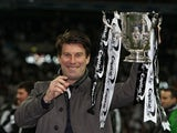 Swansea City manager Michael Laudrup celebrates with the Capital One Cup final trophy on February 24, 2013