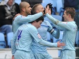 Coventry City's Leon Clarke celebrates with teammates during his side's match against Crewe Alexandra on February 23, 2013