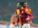 Galatasaray's Burak Yilmaz celebrates scoring for his team against Shalke on February 20, 2013