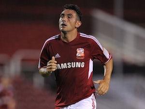 League One roundup: Swindon go top