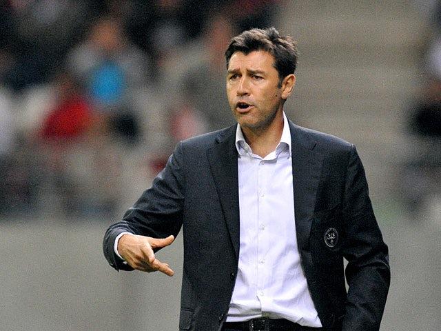 Reims coach Hubert Fournier on the touchline on September 20, 2011