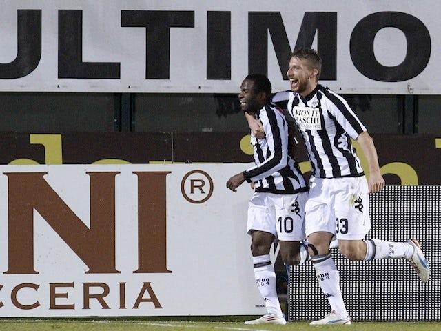 Siena's Innocent Emenghara celebrates a goal against Lazio on February 18, 2013